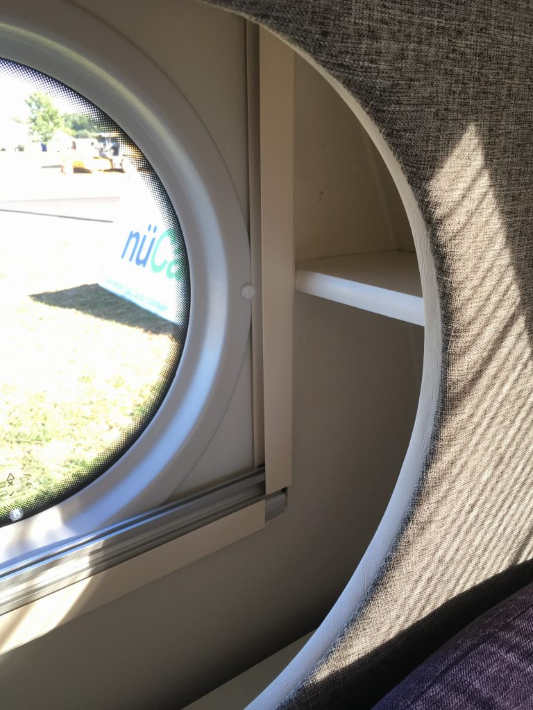 The table area includes unique storage within the porthole windows.