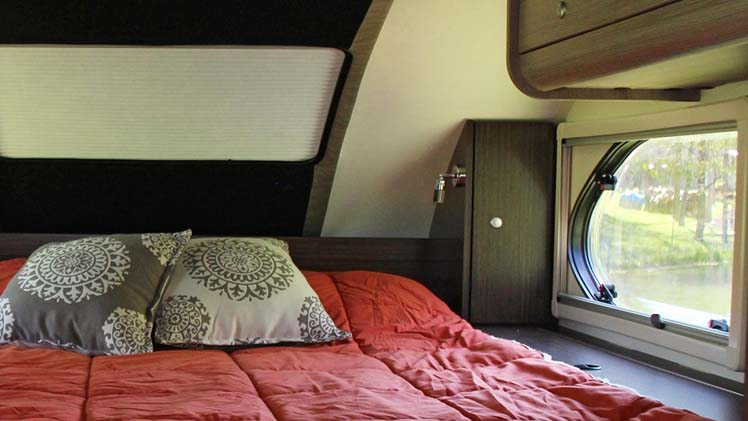 Overhead Cabinetry And Headboard With Storage Nucamp Rv