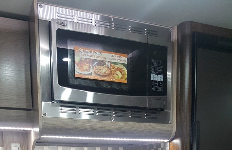 Convectional Microwave Oven in the Cirrus 920 Truck Camper