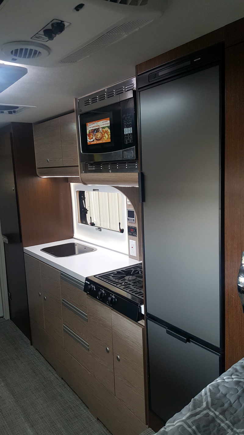 One Cabinet Over Sink and Two Below in Cirrus 920 Truck Camper